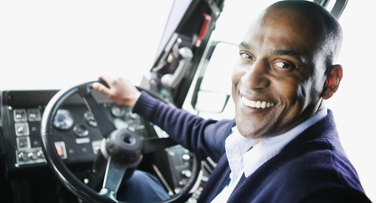 Photo of a happy bus driver